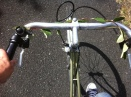 photo of front of the bike, we see eva's right foot, pedaling!