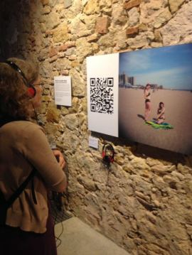 photo of person listening to the Pin-Up Girls audio QRt during an exhibit